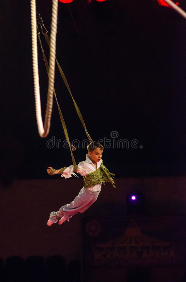 Circus show a bright arena. DNIPRO, UKRAINE - DECEMBER 9, 2017: An unidentified boy, age 12 years old, performs Air gymnastics at the Dnipro circus stock photos