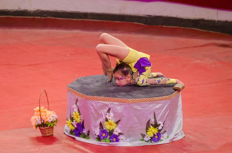 Circus show a bright arena. DNIPRO, UKRAINE - DECEMBER 9, 2017: An unidentified girl, age 9 years old, performs gymnastics at the Dnipro circus royalty free stock images