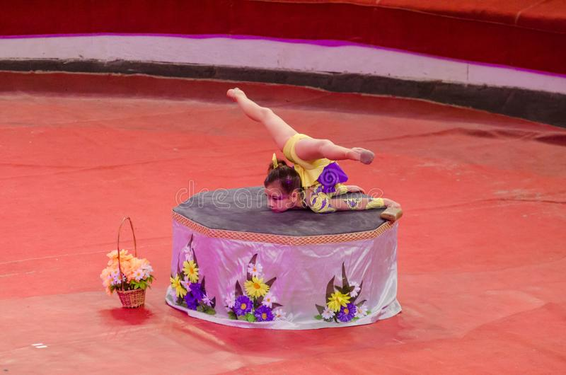 Circus show a bright arena. DNIPRO, UKRAINE - DECEMBER 9, 2017: An unidentified girl, age 9 years old, performs gymnastics at the Dnipro circus royalty free stock image