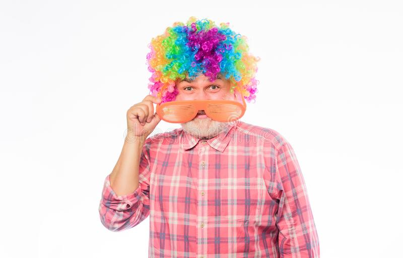 Circus show. Elderly clown. Man senior bearded cheerful person wear colorful rainbow wig. Grandpa always fun. Having fun royalty free stock image