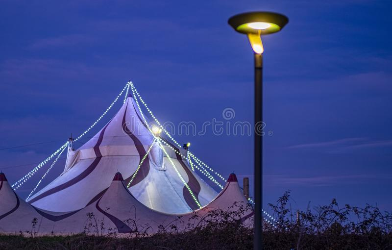 Circus structure with street lamp by night stock photography