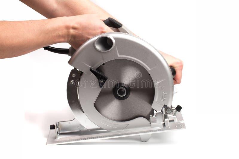 Cirkelsågar, elektriskt, handhållna Cirkelsågar är utformade för att skära trä och plast Objektet är isolerat på vitt royaltyfri foto