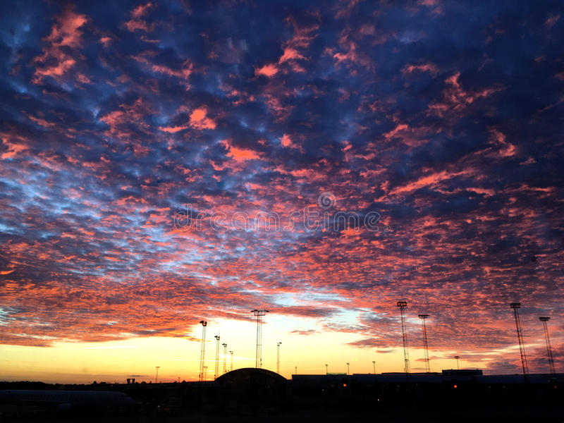 Cirrocumulus fire cloud in a sunset in airport stock photos