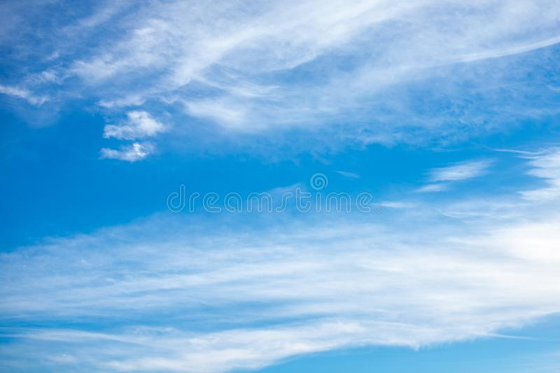 Cirrostratus clouds on blue sunny sky stock photo
