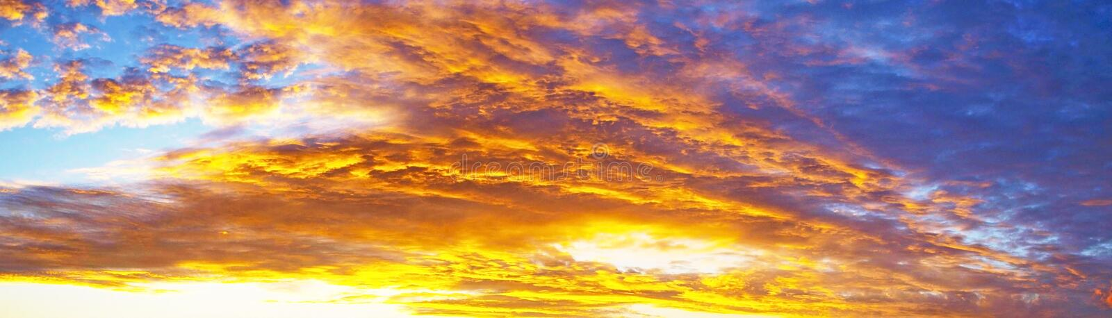 Red colored cirrus cloud, background sunset seascape. Cirrus cloud background. Sunset seascape photo art. Yellow and orange coloured picturesque cirrus cloudy royalty free stock photo