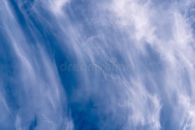 Cirrus cloud prism. High cirrus clouds refract the early morning sun like a prism causing a small rainbow royalty free stock images