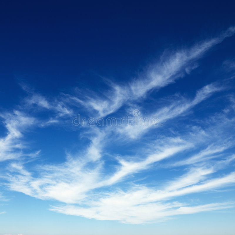 Cirrus clouds in blue sky. stock images
