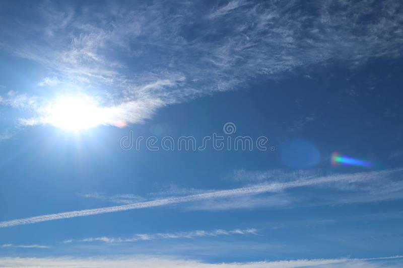 Cirrus clouds on a clear blue sky. Weather forecast. Water in a gaseous state in nature. The atmosphere of the earth. The effect o. F humidity on agricultural stock images