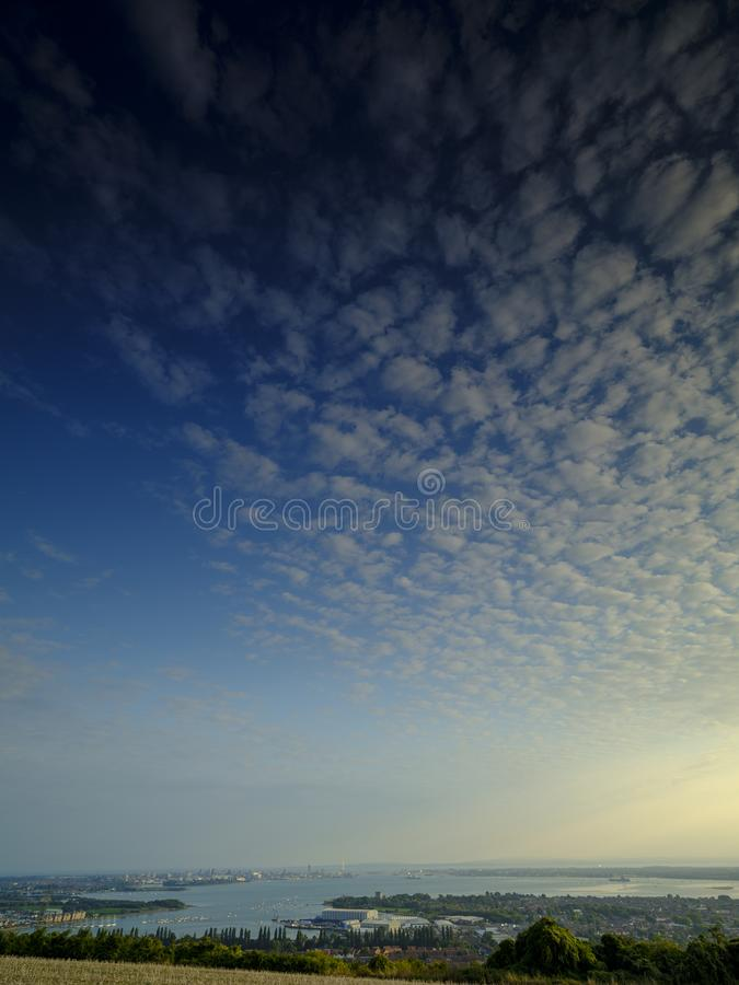 Cirrus clouds over Portsmouth Harbour, Hampshire, UK stock images