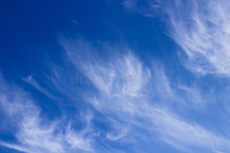 Cirrus clouds. Photo beautiful cirrus clouds on a sunny day in autumn royalty free stock photo