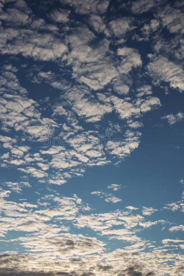 Cirrus cumulus clouds on a blue sky. Background blank texture stock photography