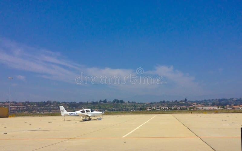 Cirrus SR22 in Camarillo airport, CA. CAMARILLO, CA - MAY 28, 2014: Light single engine small aircraft Cirrus SR22 parked at public Camarillo reliever airport ( royalty free stock image