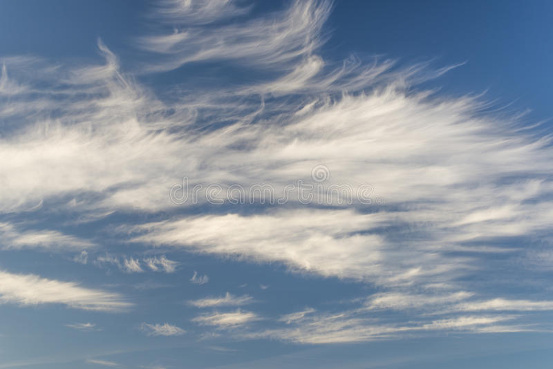 Cirrus Uncinus clouds. Thin wispy strands of Cirrus Uncinus clouds royalty free stock photography