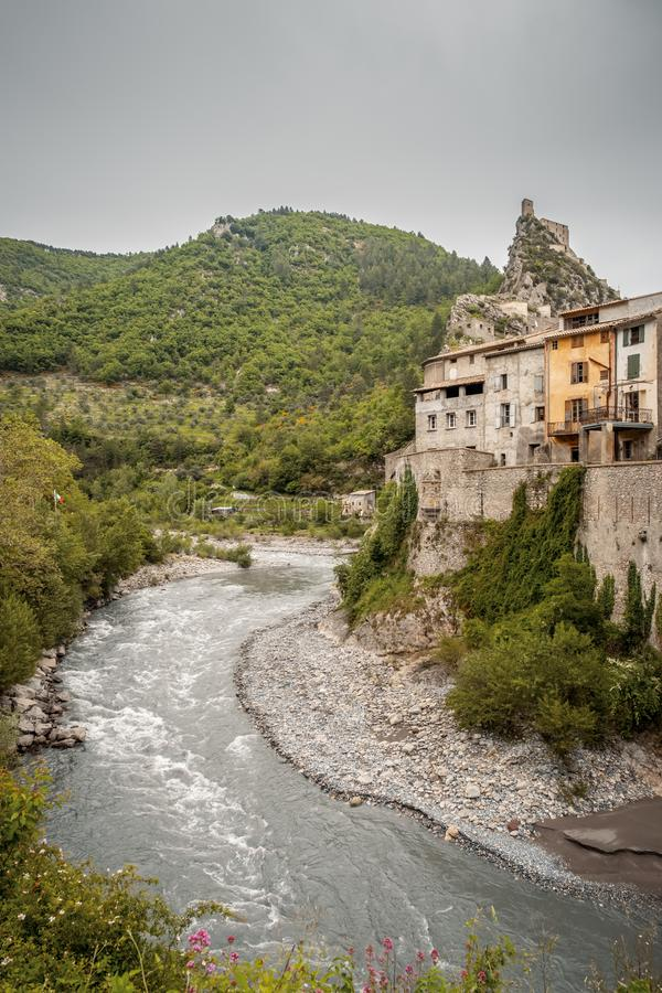 The citadel of Entrevaux and Var river in France. The medieval citadel of Entrevaux sits high on a rocky outcrop above the town and the Var valley in the Alpes royalty free stock images