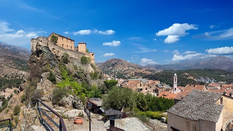 Citadel and historical city of corte corsica. Famous citadel and historical city of corte in corsica france on rock wide panorama stock photo