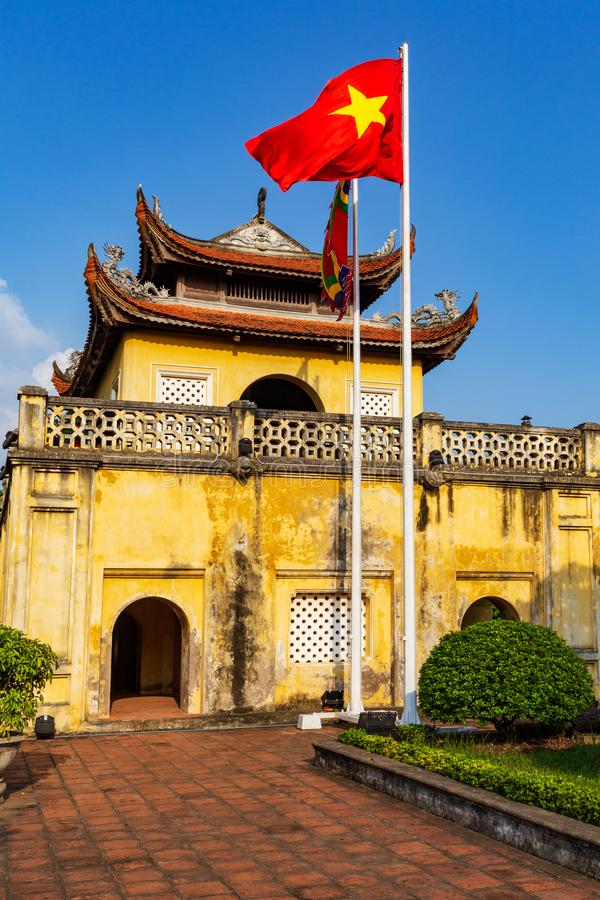 The Citadel of Thang Long imperial city in Hanoi with Vietnamese national flag, Vietnam. UNESCO World Heritage Site. The Thang Long citadel part of the central royalty free stock images