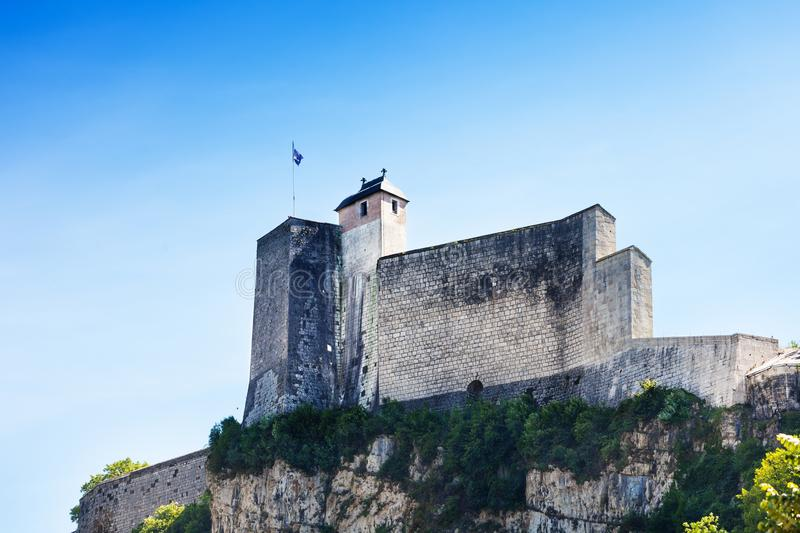 Citadel of the walled city in Besancon, France. Low angle view of the citadel of the walled city in Besancon against blue sky, France stock photo