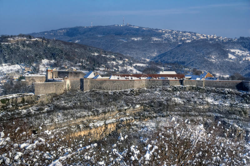 Citadelle of Besancon. Part of the Citadelle of Besancon on a cliff, in France during winter. The fortifications were made by the architect Vauban royalty free stock photography