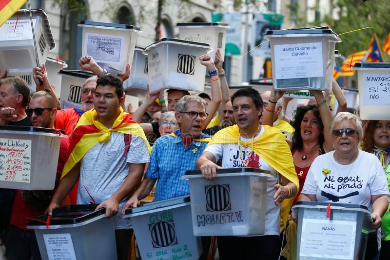 Citizens marching during a demonstration in barcelona royalty free stock photo