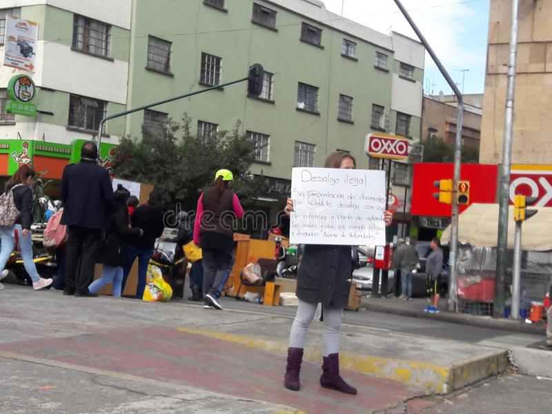Citizens protesting in Mexico urb megalopolis lodgment police. Gentrification protest in megacity of mexico desalojamiento forced expropiation due to stock photo