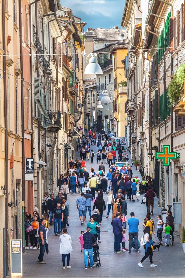 Citizens and tourists walking through Via Roma in the historic center of Rieti in Italy. stock image