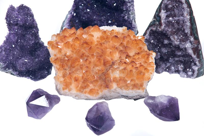 Citrine druzy cluster surrounded by amethyst druzy clusters and points stock illustration