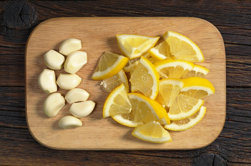 Citroen en knoflook stock fotografie