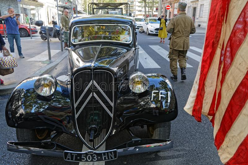 A Citroen Traction and a US flag in Lyon stock photo