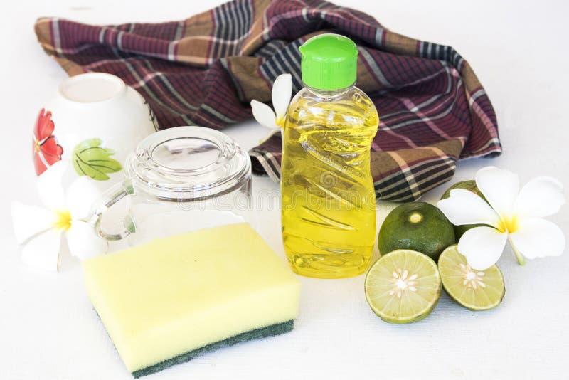 Citron de fines herbes d'extrait de liquide de lavage de plat pour propre photos stock
