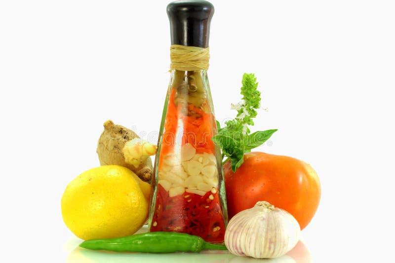 Citron et tomate avec l'épice images libres de droits