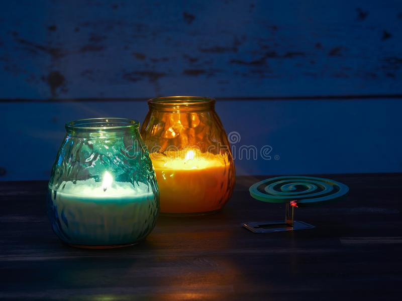 Citronella candles and mosquito spiral. Used to keep the nasty insects away stock photo