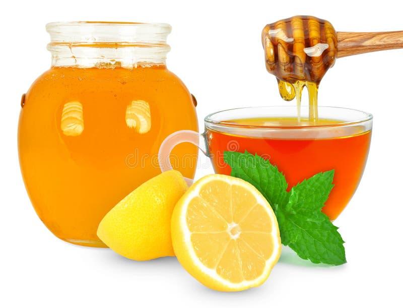 Citronte med honung arkivfoto