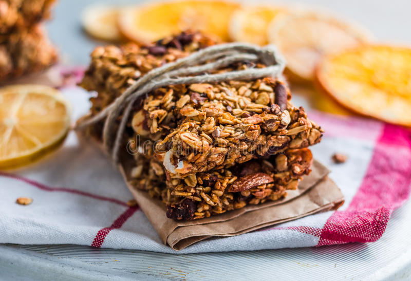 Citrus bars granola with oatmeal, seeds, nuts and dried fruits stock images