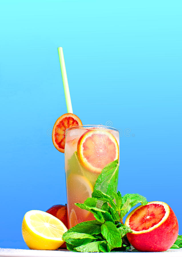 Citrus cold lemonade on a blue background royalty free stock photos