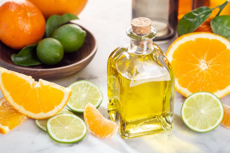 Citrus essential oil. Citrus oil on glass bottle. Skin care products royalty free stock images