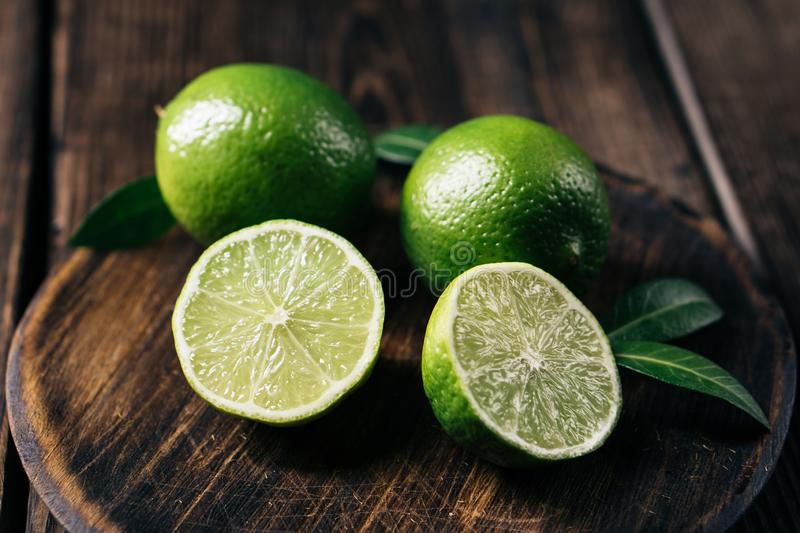 Citrus, fresh limes, tropical fruits background royalty free stock images