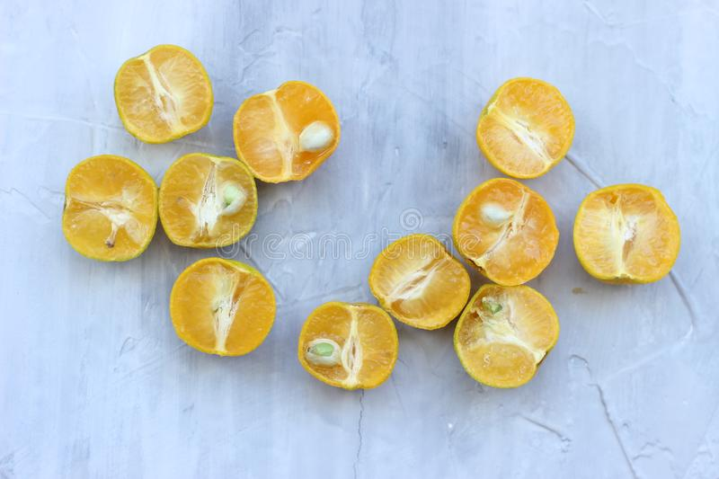 Citrus fruit on dark grey concrete table. Food background. Healthy eating and diet. stock image