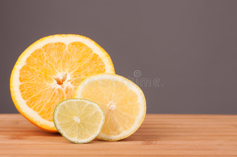 Citrus fruit. S on the wooden table, white background in the range stock image