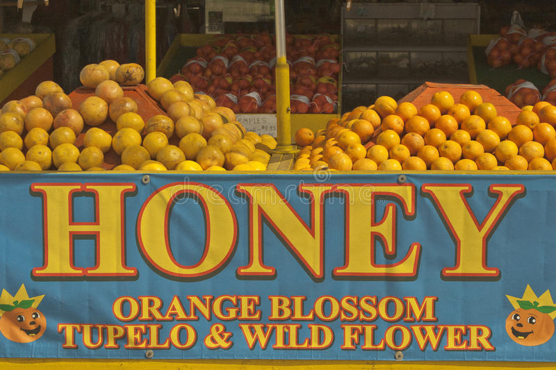 Citrus Fruit And Honey For Sale Editorial Image