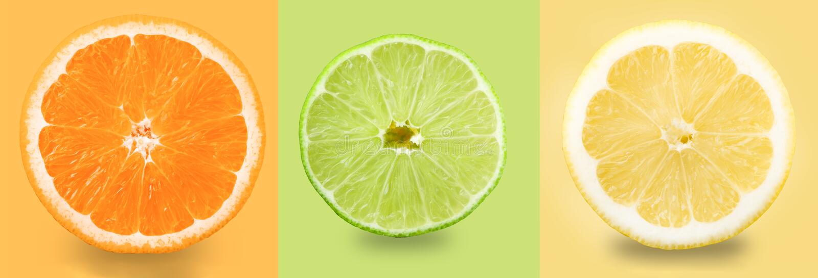 Citrus fruit. Orange, lemon, lime. Slices isolated on a colored background. Collection royalty free stock photography