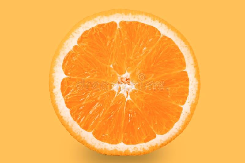 Citrus fruit. Orange orange slice on orange background, isolate.  stock photo