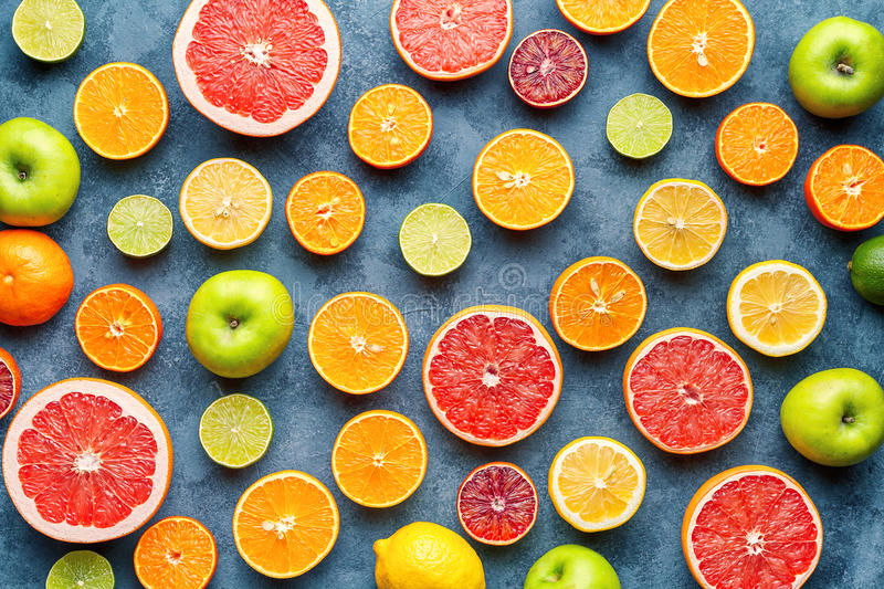 Citrus fruit pattern on grey concrete table. Food background. Healthy eating. Antioxidant, detox, dieting, clean eating. Organic fruit food background. Citrus royalty free stock image