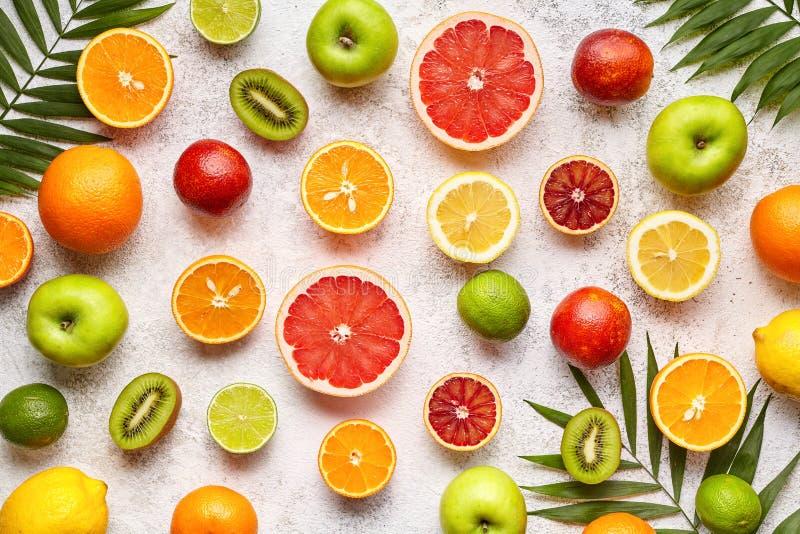 Citrus fruits background mix flat lay, summer healthy vegetarian food, antioxidant detox nutrition diet. Tropical vegan assortment mix grapefruit, coconut stock photos