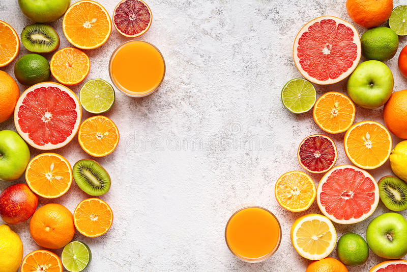 Citrus fruits frame vegan vitamin mix flat lay on white background, healthy vegetarian organic food royalty free stock images