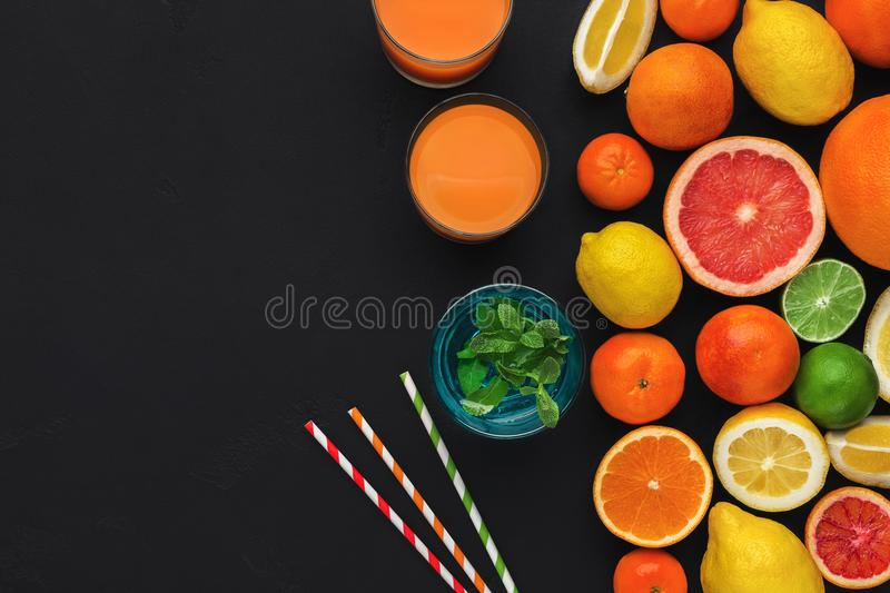 Citrus fruits and glass of fresh juice royalty free stock photos