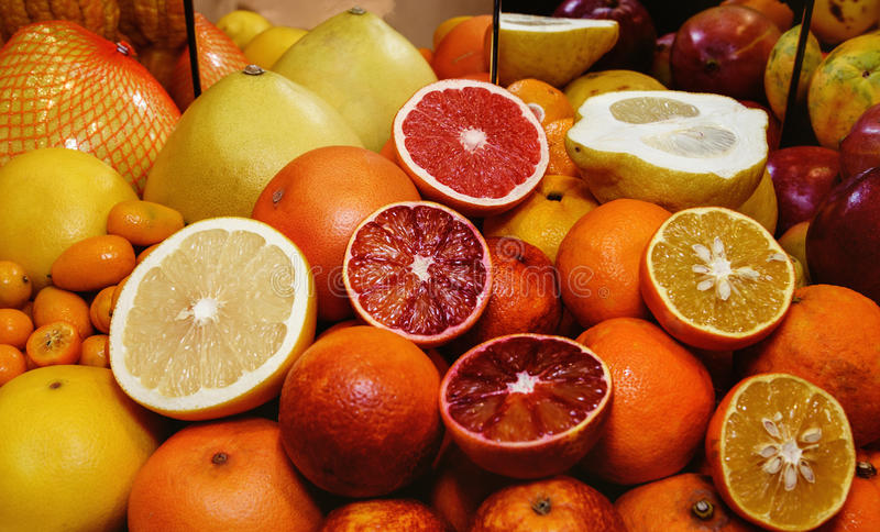 Citrus fruits. Grapefruits, oranges, pamela, kumquat. Concept of healthy eating,. Citrus tropical fruits. Concept of healthy eating, abstinence from meat royalty free stock images
