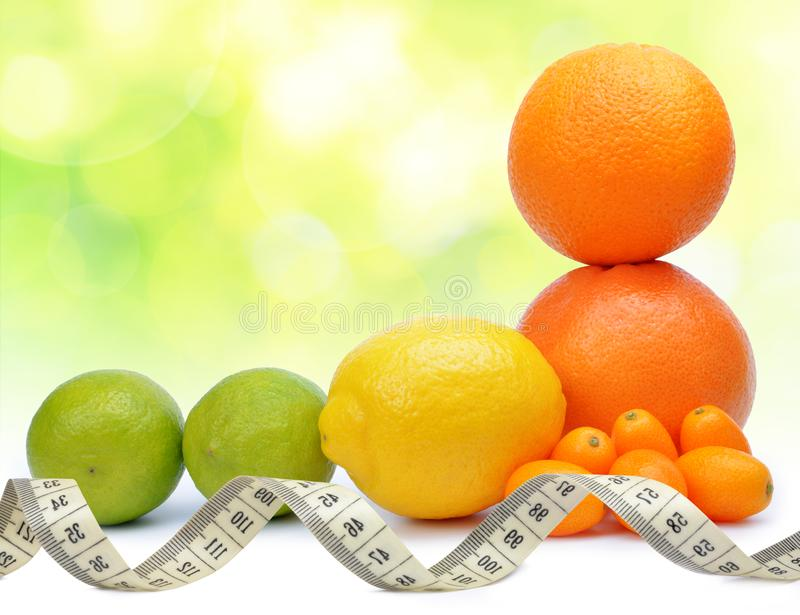 Citrus fruits Orange, Grapefruit, Lemon, Lime, Kumquat with measuring tape. stock image