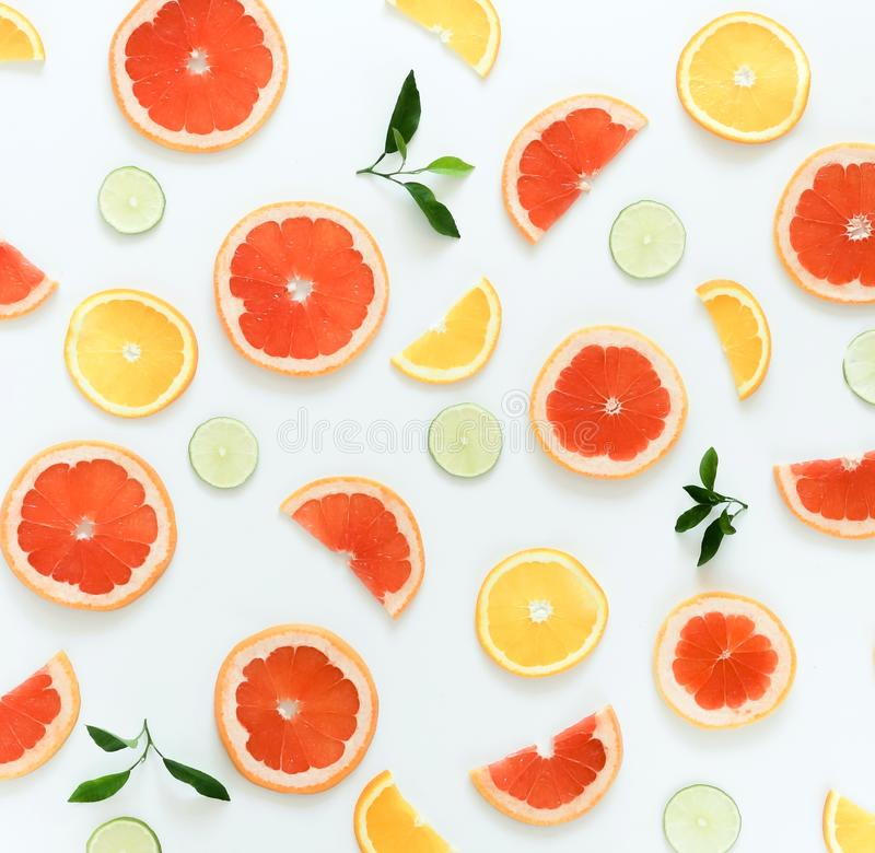 Citrus fruits pattern composition top view background. Lime, grapefruit, orange, on white background. Summer food concept. Flat lay royalty free stock photography