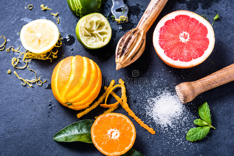 Citrus fruits for summer refreshing lemonade. Lay flat from overhead. Ingredients for healthy drink royalty free stock images