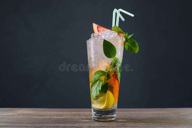 Citrus lemonade with grapefruit and basil, refreshing cold iced stock photography